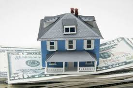 small house on top of money pile